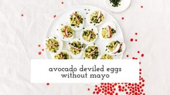 A plate filled with deviled eggs with mayo are photographed from the top view.