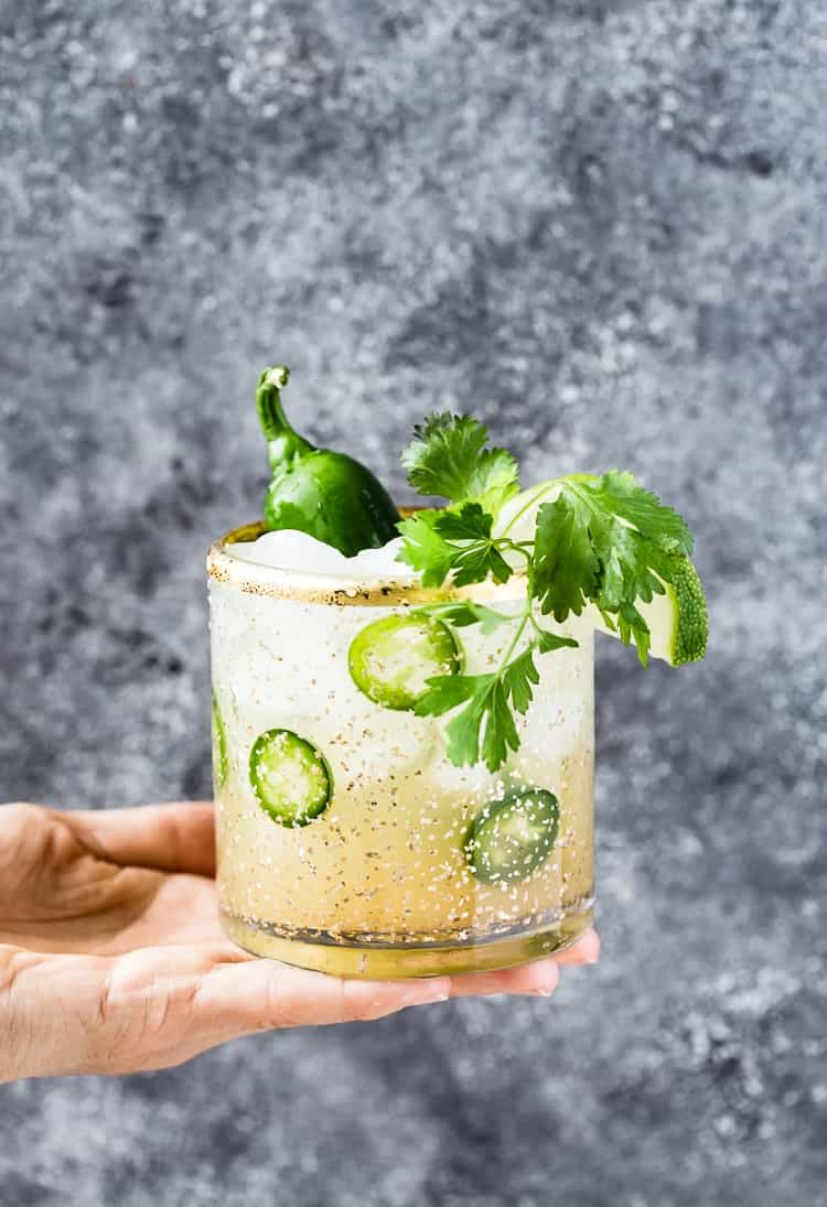 Jalapeno margarita being served by a woman - Easy Mexican Recipes and Cocktails