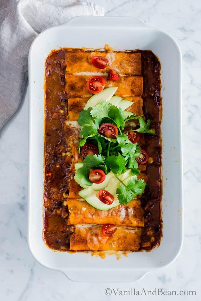 Sweet Potato Wrapped Black bean Enchiladas in a casserole dish