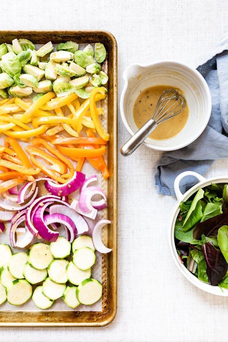 Lemon Vinaigrette Dressing with sliced veggies and greens on the side