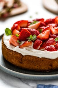Almond Flour Strawberry Cake garnished with mint