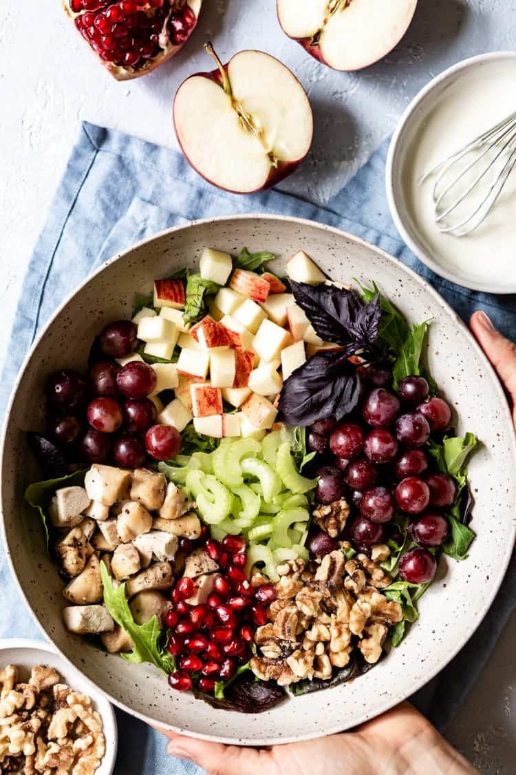 Chicken Salad with Grapes and Apples placed in a bowl photographed from the top view.