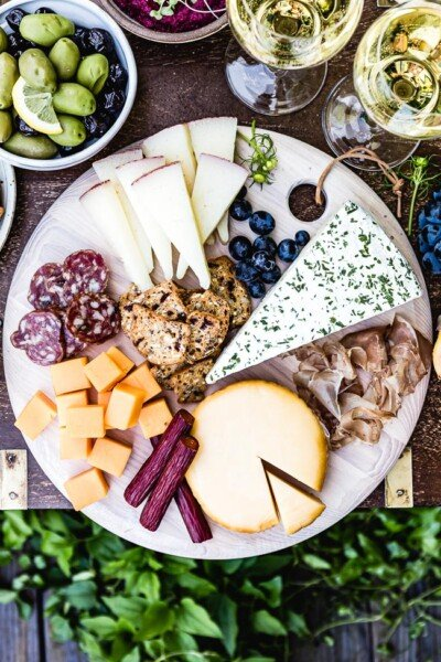 Meat and Cheese Platter (Charcuterie Board) served with wine on the side