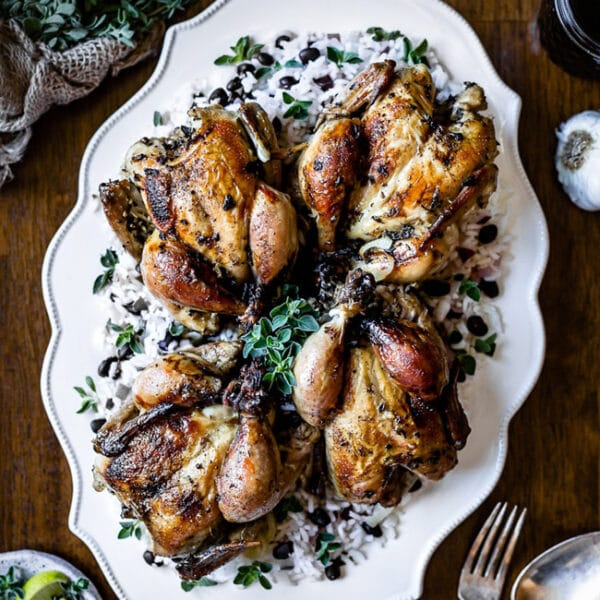 Cornish Hen recipe placed on a large plate and photographed from the top view.
