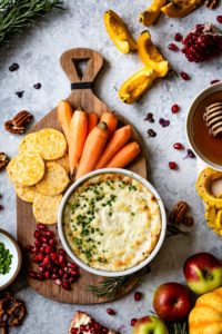 Baked Goat Cheese Dip recipe served with vegetables and crackers
