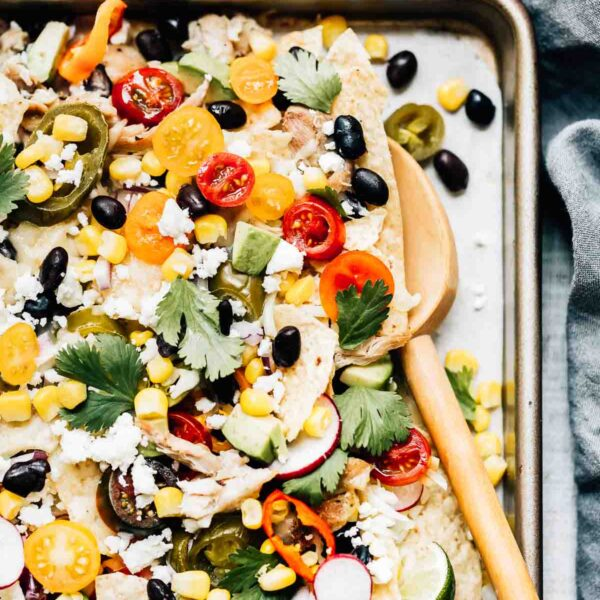 Healthy Game Day recipes round up - Chicken Nachos with a wooden spoon on the side
