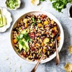 This Texas Caviar (aka Cowboy Caviar)loaded with black-eyed peas, corn, tomatoes, peppers, and tangy lime dressing makes the best salad, dip, or side dish.