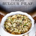 A bowl of Turkish Bulgur Pilaf in the hands of a person