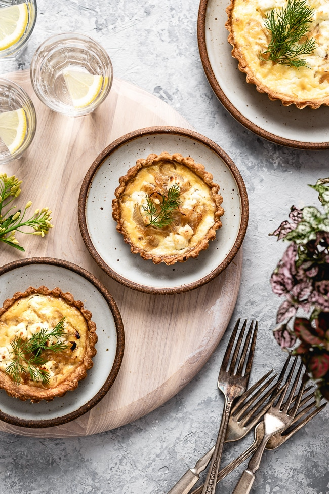 Several servings of goat cheese quiche are photographed over the top view