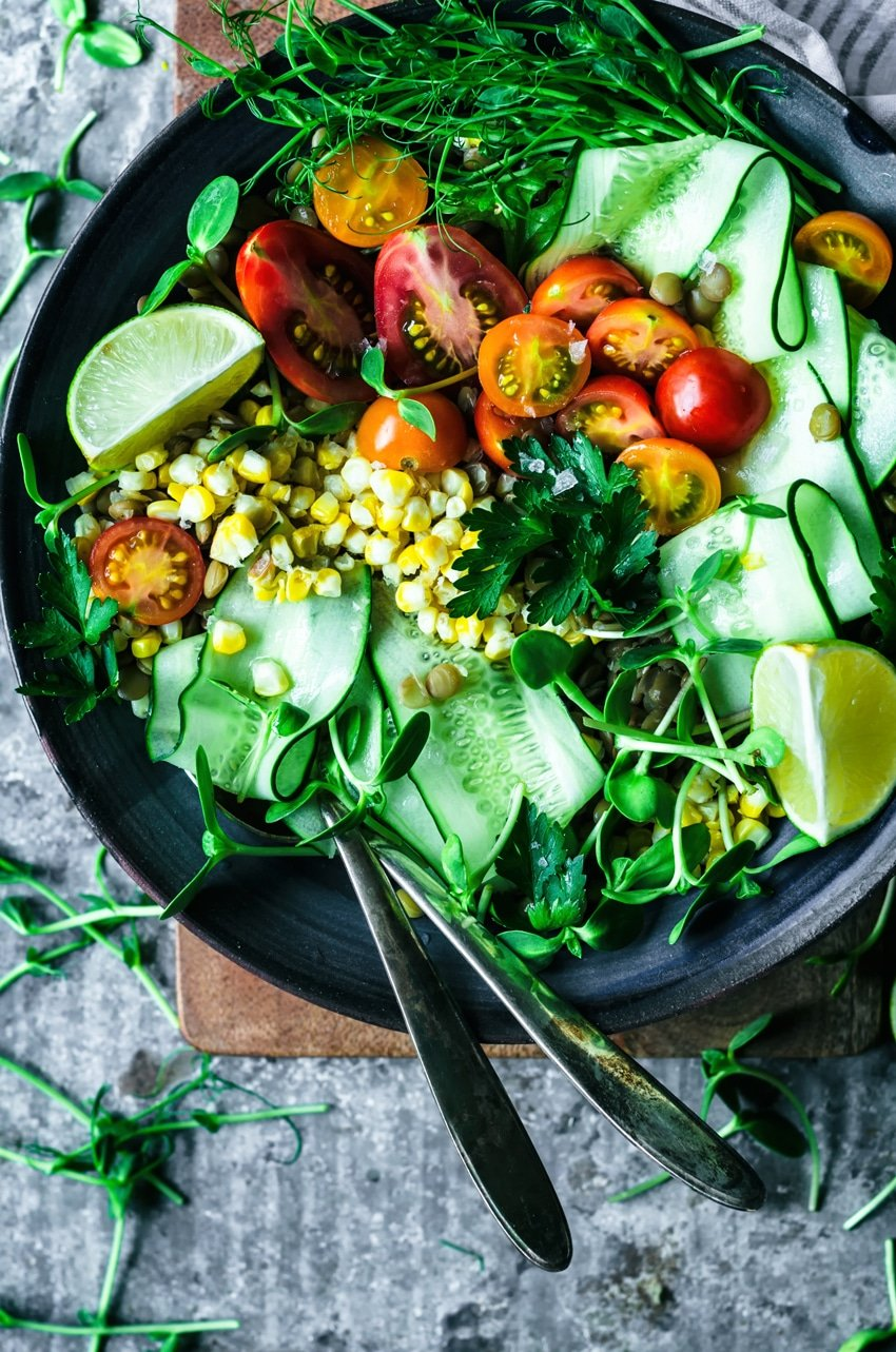 Mexican Lentil Salad in a large bowl on a cutting board