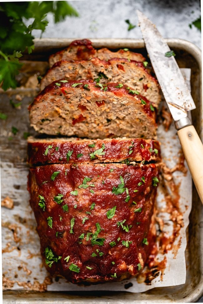 A healthy turkey meatloaf sliced and photographed from the top view.