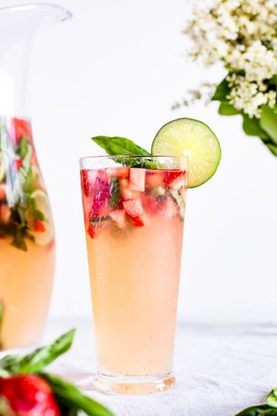 Strawberry Basil Limeade garnished with a lime slice in a glass