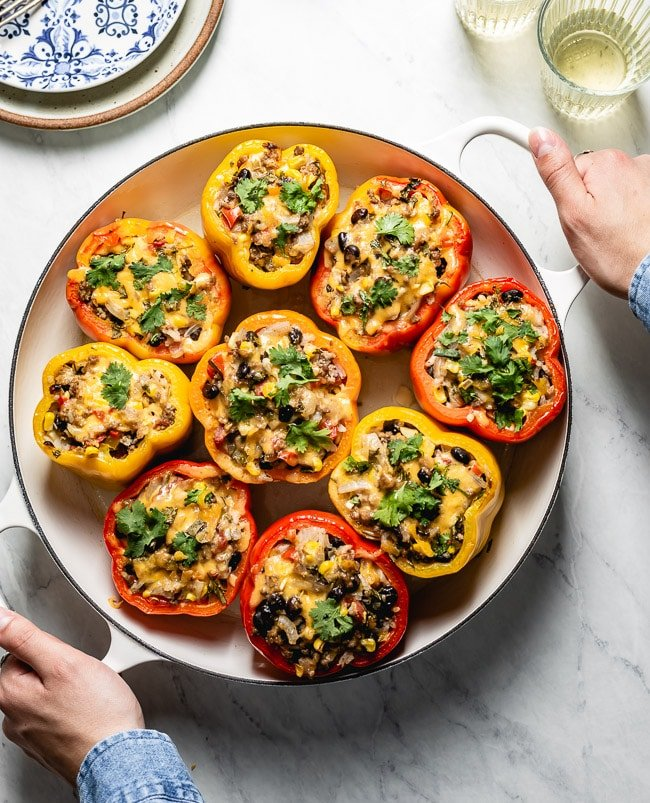 Fresh out of the oven stuffed bell peppers recipe is being served on a table
