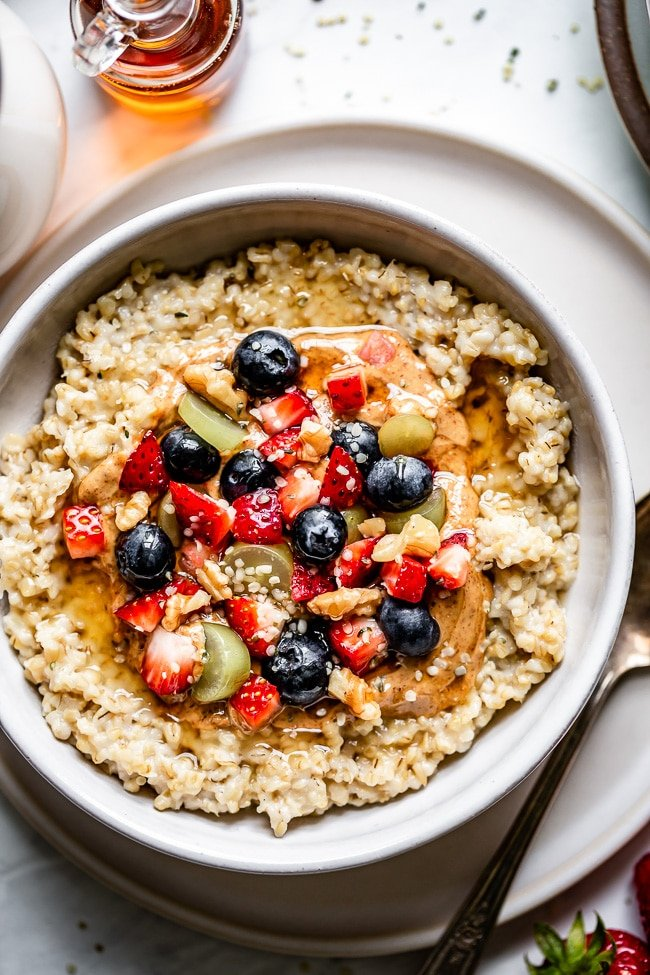A bowl of Healthy Pressure Cooker Steel Cut Oats Recipe topped off with fruit