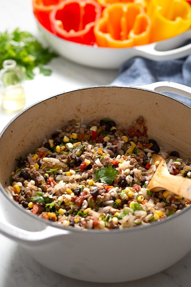 The filling made with ground beef, corn, and black beans for Mexican Stuffed Peppers