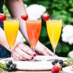 Colorful mimosas with different flavors including Blood Orange Mimosa