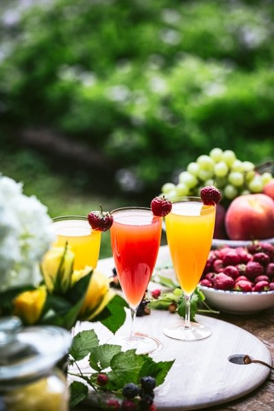 Blood Orange Mimosa and other flavored mimosas are photographed together.