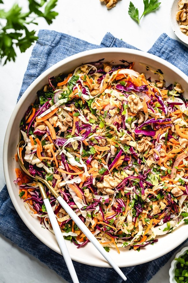 Healthy No Mayo Coleslaw recipe mixed in with homemade sugar free vinegar recipe photographed from the top view.