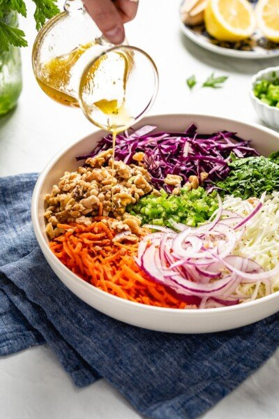 Vegan Vinegar Based No Mayo Coleslaw Recipe drizzled with a homemade dressing