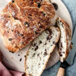 A loaf of olive bread sliced