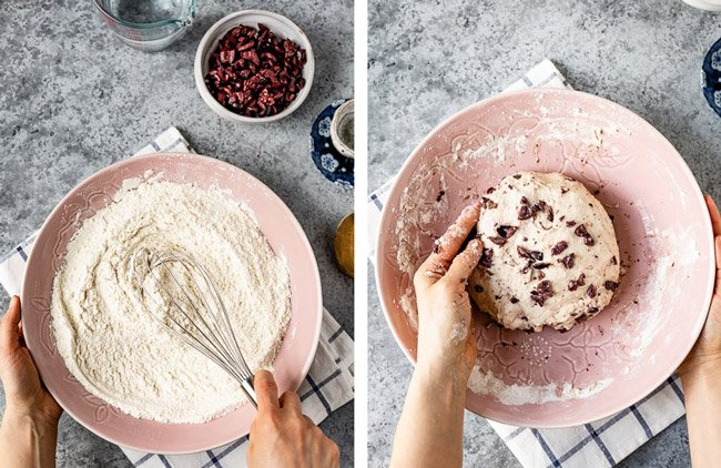 A woman's hand are photographed from the top view as she is making a homemade olive bread recipe