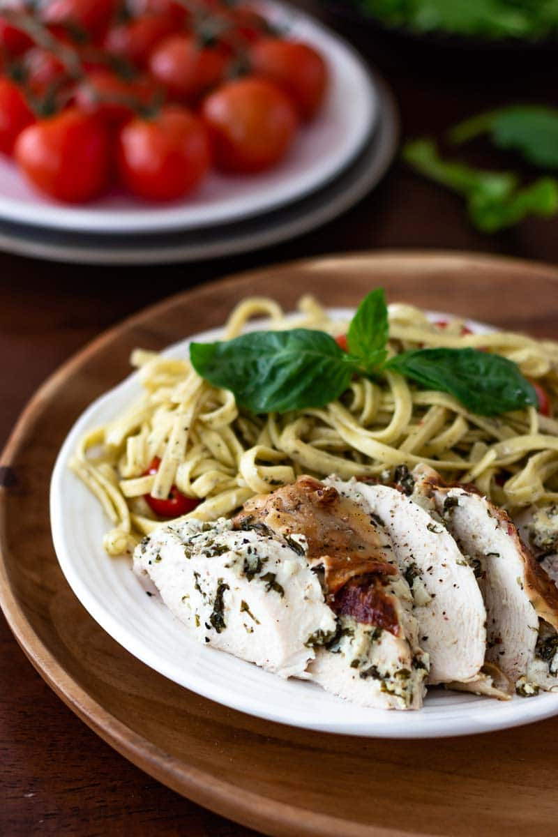 Chicken flavored with goat cheese sliced and served with pasta