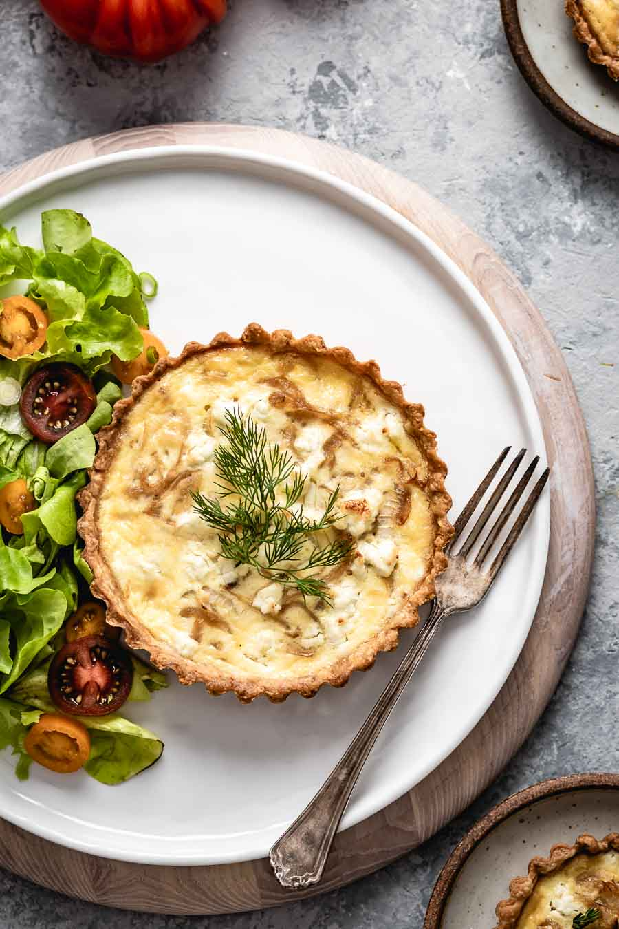 Goat cheese quiche with green salad on the side.
