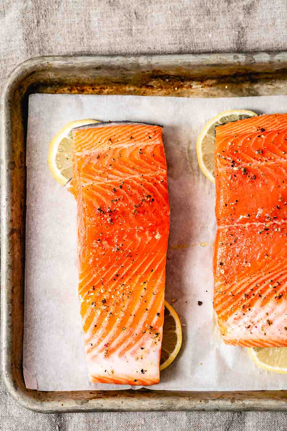 Learn how to cook salmon in the oven for a delicious salad recipe - fish photographed from the top view before it goes into the oven.