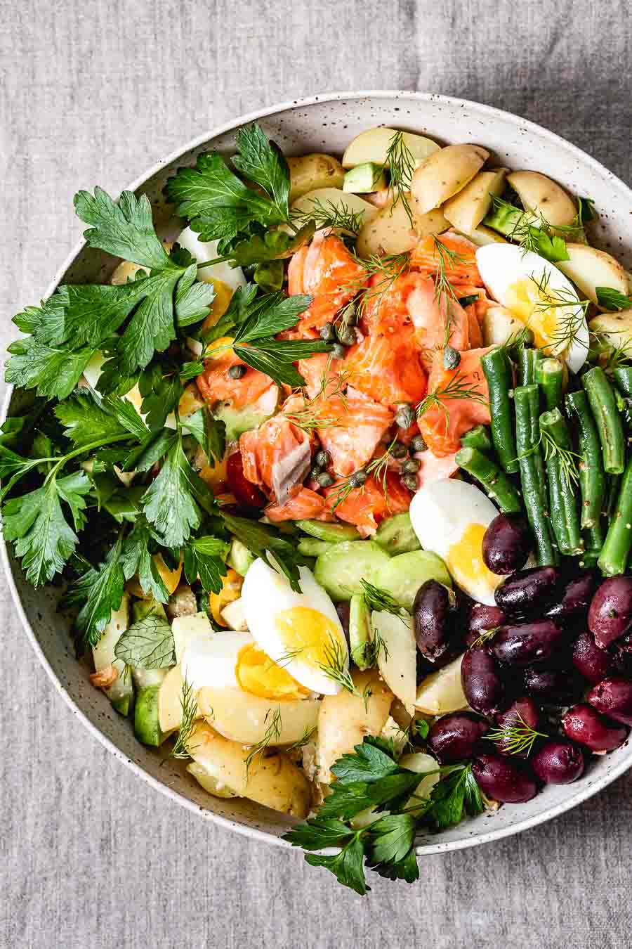 A bowl of Salmon Nicoise salad recipe from the top view
