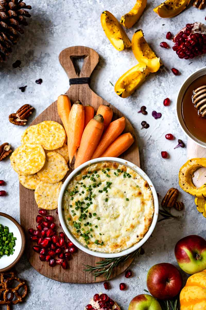 Baked goat cheese dip served with veggies, fruits and crackers.