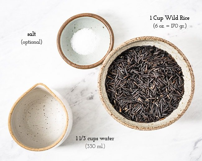 Ingredients (wild rice, water, and salt) are laid out for the perfect wild rice water ratio to cook wild rice in an instant pot