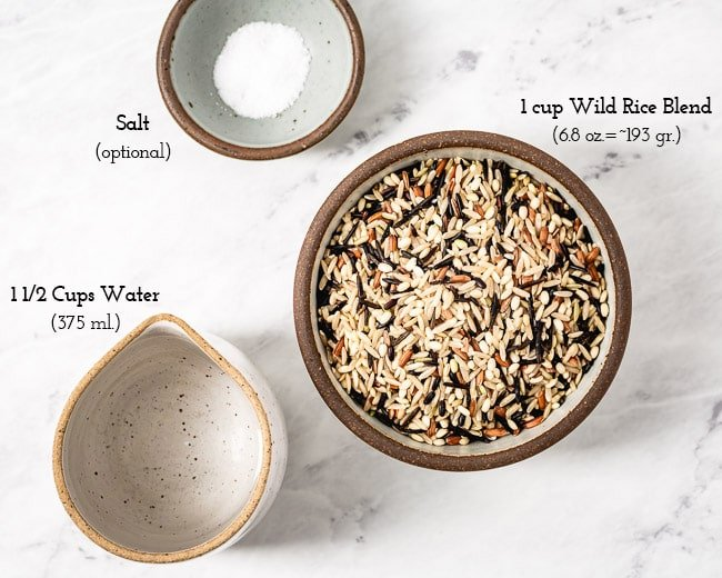 The ingredients (wild rice blend, water, and salt) are laid out for the perfect ratio of water and wild rice blend to cook the best instant pot wild rice blend