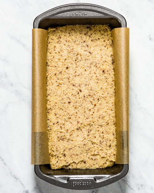 homemade low carb bread batter is placed in a loaf pan and photographed from the top view.