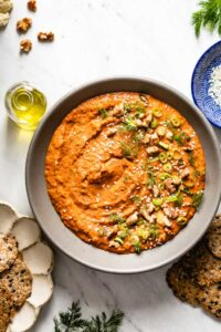 A bowl of muhammara recipe is photographed from the top view