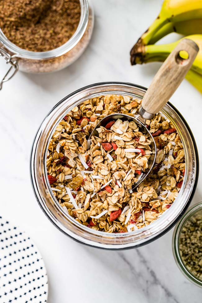 A jar filled with homemade chunky granola recipe photographed from the top view.