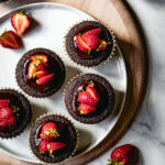 Chocolate muffins with strawberries on top