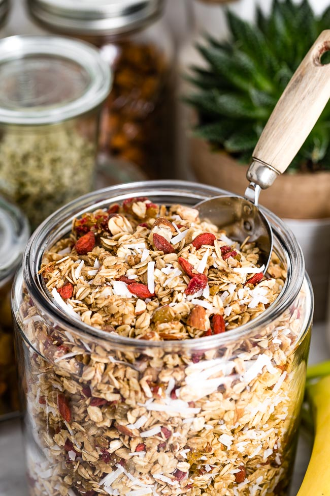 Healthy Granola Recipe with Clusters photographed in a glass jar from the front view