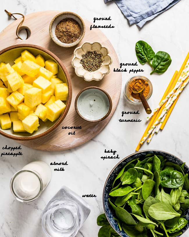 Ingredients for Green Smoothie with Turmeric are photographed from the top view.