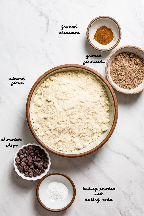 Dry ingredients for the best healthy banana bread with almond flour are laid out and photographed from the top view.