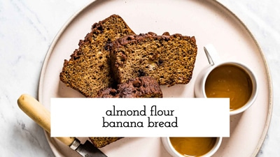 Almond Flour Banana Bread Sliced on a plate served with coffee