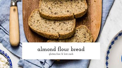 Sliced almond flour bread on a cutting board