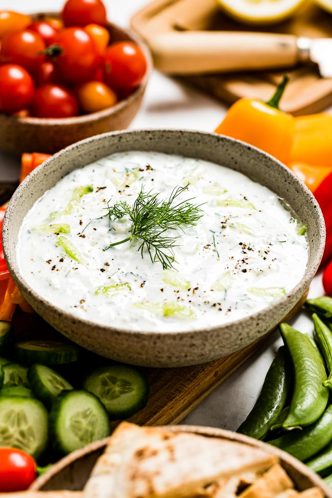 A bowl of Turkish cacik is served with fresh vegetables