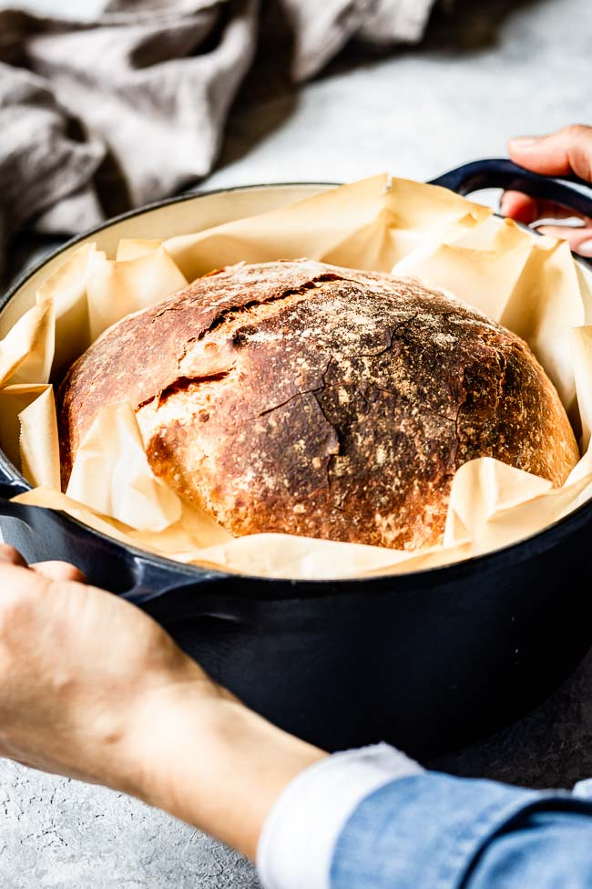 Homemade No Knead Bread is being served in a dutch oven