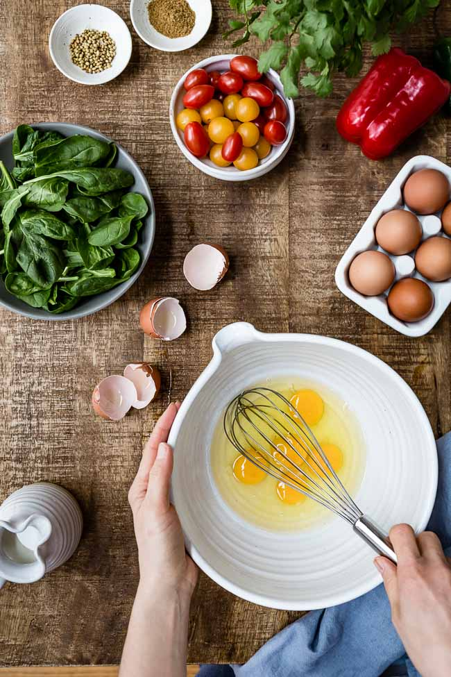 Fridge essentials like eggs, spinach, tomatoes and spice