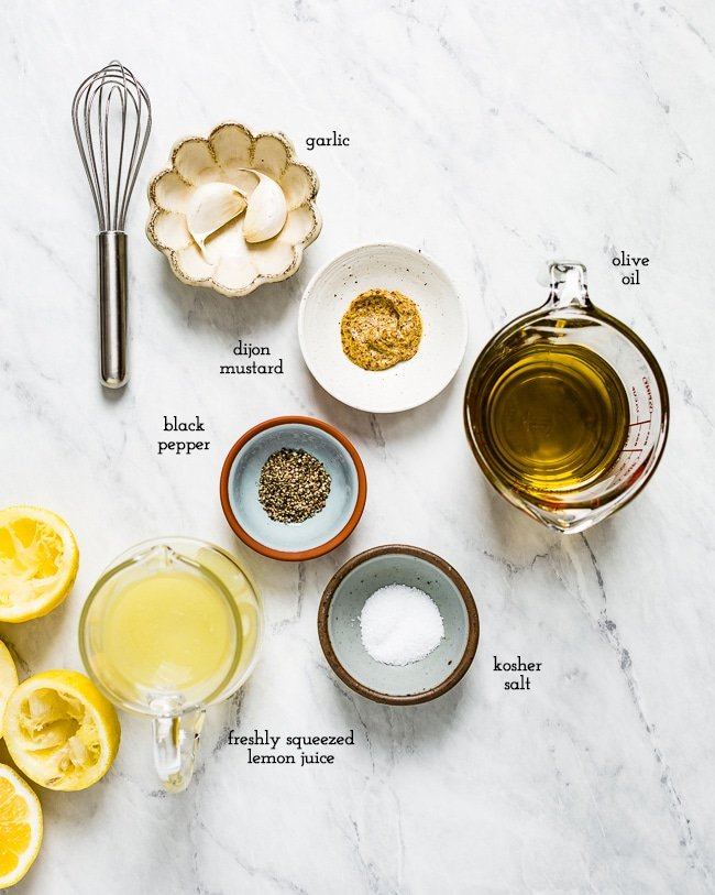Ingredients - lemon juice, garlic and olive oil, are laid out