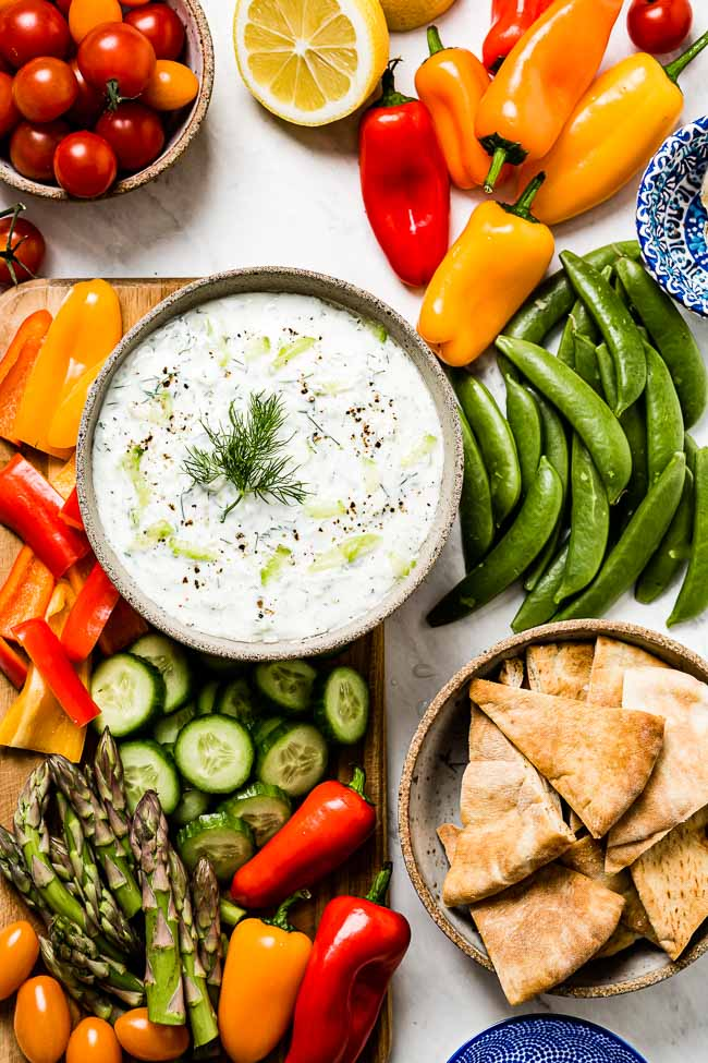 Authentic Tzatziki Sauce Recipe is served with colorful fresh vegetables
