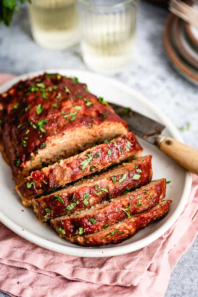 Ground Turkey Meatloaf recipe is sliced and displayed from the front view