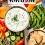 Tzatziki Sauce in a bowl with vegetables around