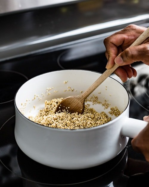 Toasting quinoa with spices to bring out its flavors