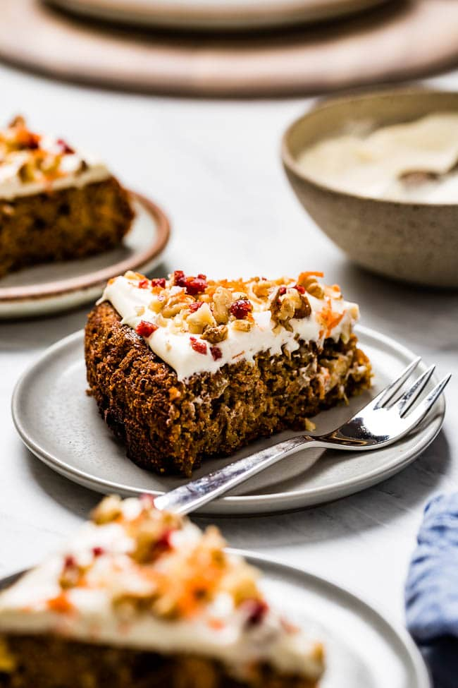 A slice of healthy carrot cake recipe is photographed from the front view